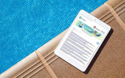 Vista del Boletín del SID en una tablet en el borde de una piscina